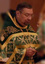 Fr Paul Merculief in liturgy