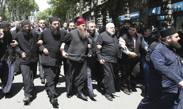 Georgian Orthodox Clergy Take To The Streets To Disrupt 'Gay Pride' Parade