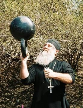 Fr. Peck with kettlebell and gripper