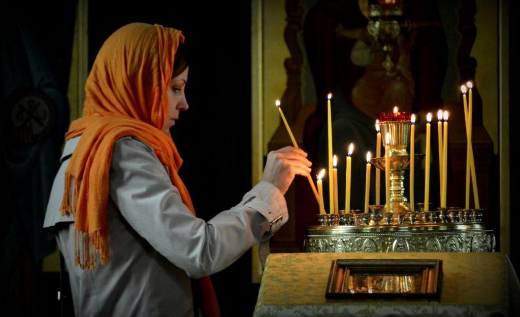 woman prayer candles